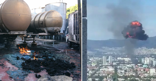a set of alcohol tanks with a flame near it, a smoke explosion hovering over mexico city
