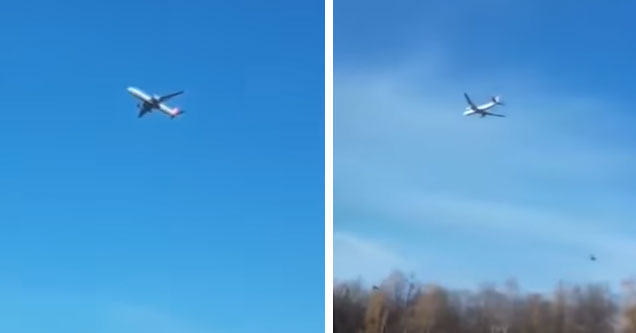 a large 747 style airplane that appears to be floating in the sky