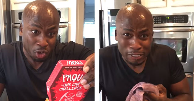 a man holding a pack of paqui pepper chips and sweating profusely and visibly in pain
