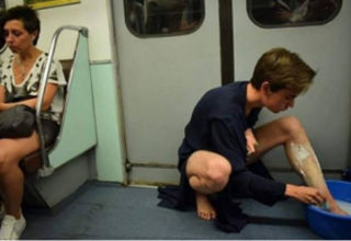 boy shaving legs in subway.