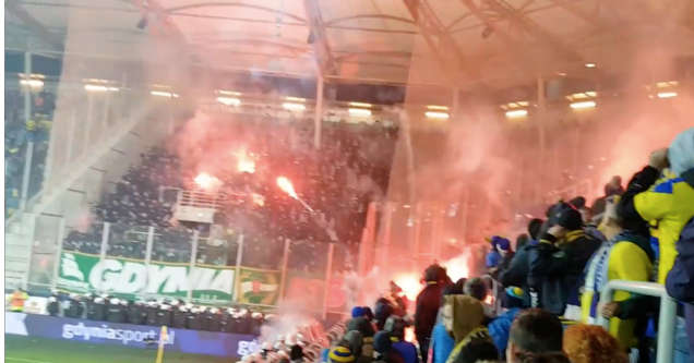 soccer fans hurling roman candles at each other.