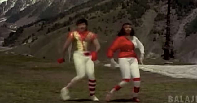 indian break dancing music group in red costumes.