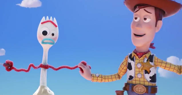 Woody from toy story holding a spoon with pipecleaner arms