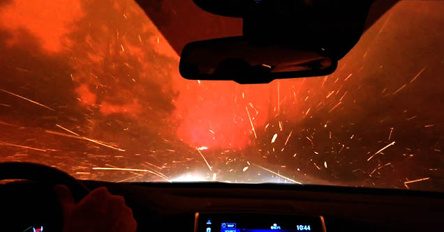 A family drives through flames as they escape the Paradise wildfire in California in November, 2018.