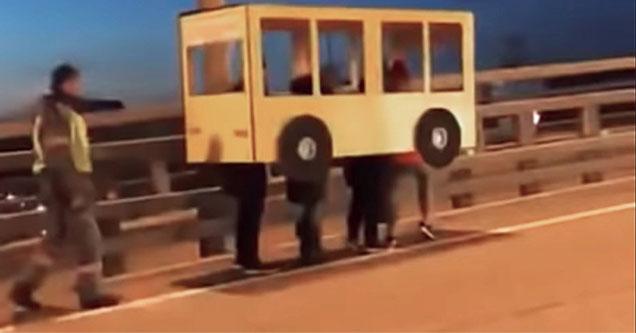 guys dress as bus to get across bridge.