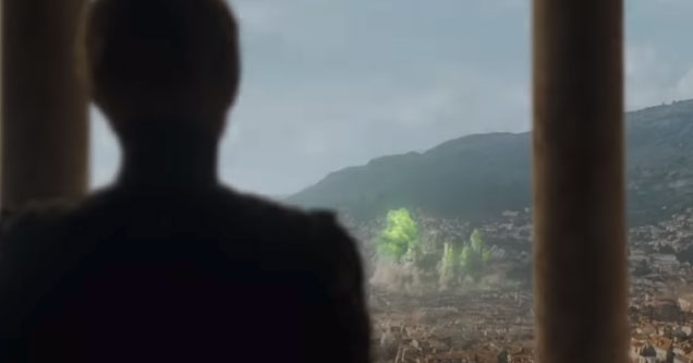 cersei lannister standing in front of the  city looking out after an explosion