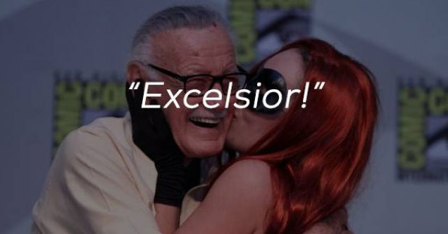 stan lee being kissed by a head headed woman wearing a mask