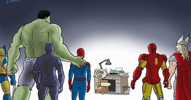 Superheroes look at Stan Lee's empty desk.