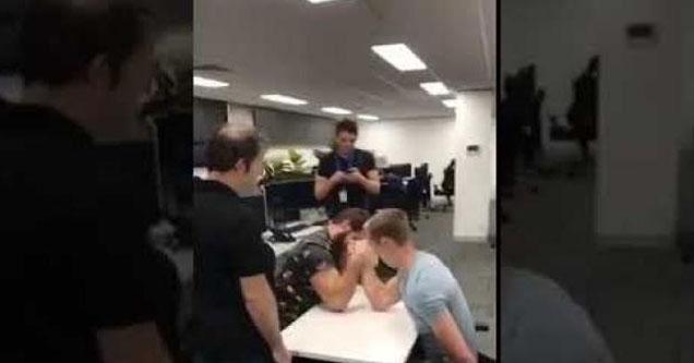 Guys arm wrestling.