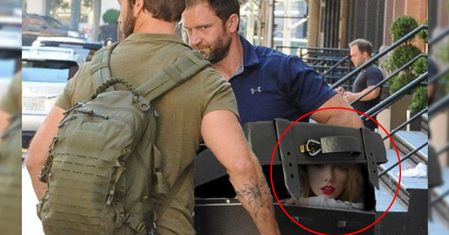 Taylor swift photoshopped in a trunk.