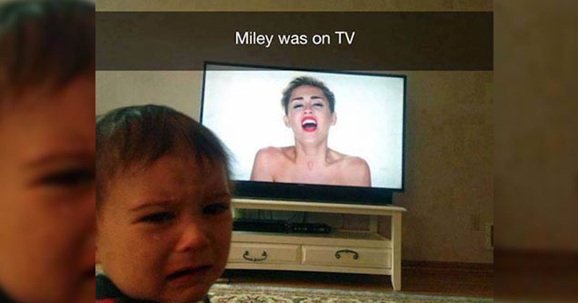 Kid crying watching miley cyrus on tv.