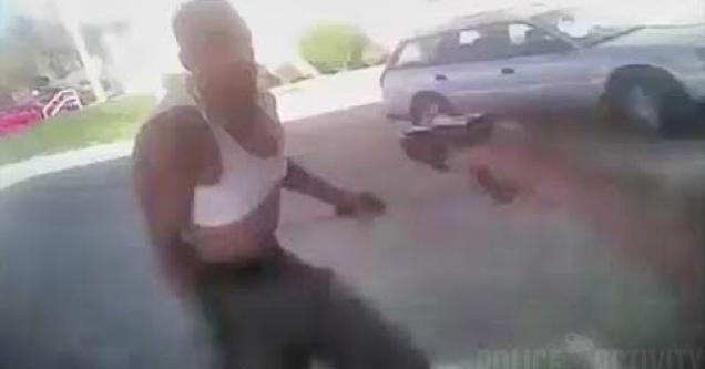 Cop draws his gun on guy.
