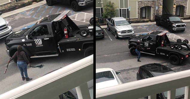 A woman holding a baseball bat is attacking a black pickup truck that is towing her car away during a repossession in Chattanooga, Tennessee in 2018.