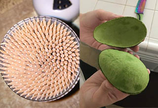 a container filled with pencils and an avacado that is opened perfectly