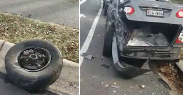 a tire lying on the side of the road and a busted up car with its trunk wide open