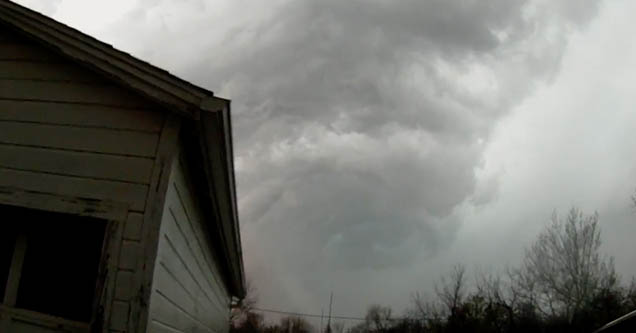 A huge tornado begins to form outside of Tulsa, Oklahoma as seen from the backyard of a man's house in June, 2015.