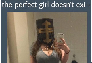 a busty girl taking a selfie wearing a crusader style knight helmet with text that says the perfect girl doesnt exist