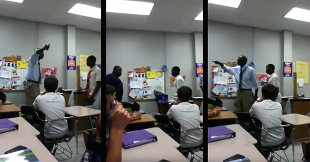 Teacher stops fight between two students.