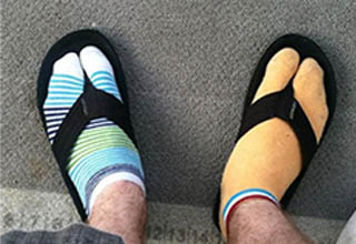 mismatched socks and sandals.