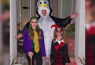 Halloween with joker harley quinn and a real penguin.