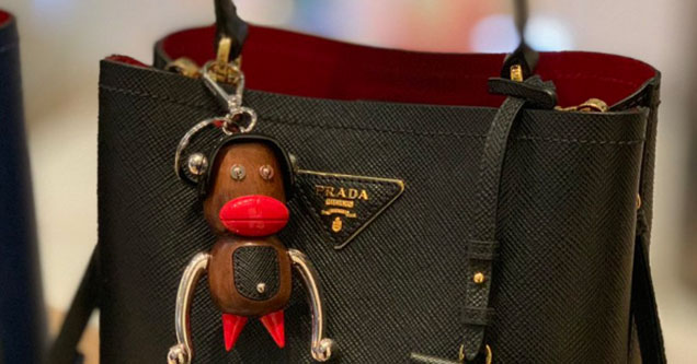 A black face doll on a purse.