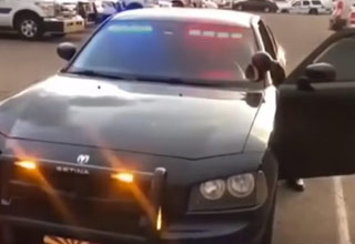 a black dodge charger with red and blue police lights flashing