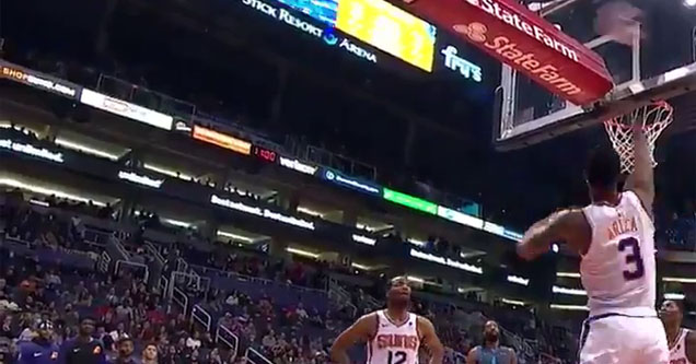 two phoenix suns players attempting to dislodge a basketball on their home court