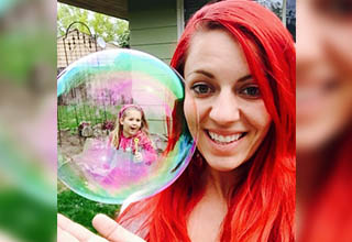 Red head with bubble with friend inside.