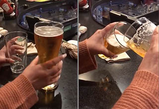 A man pours beer from a large glass into a small glass to prove that they hold almost the same volume of beer at an Applebee's in 2019/