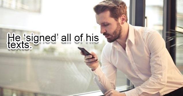 Man texting on his phone near window.