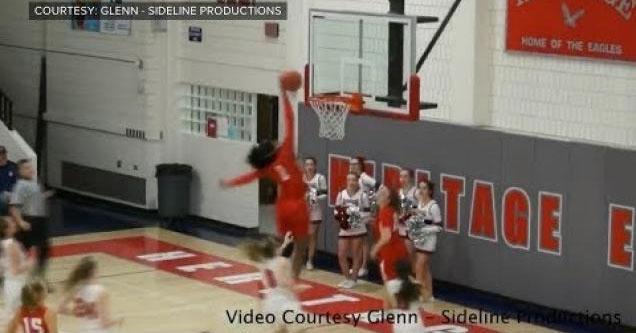 Fran Belibi throwing down a dunk.