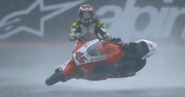 a motocycle racer named tetsuta nagashima surfing on his motorcycle after crashing