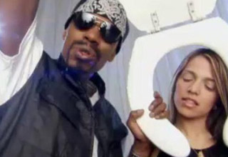 a photo from a dave chappelle sketch where hes playing R Kelly in a pee on you music video