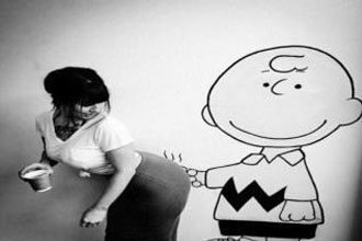 Charlie Brown with a finger on a girl.