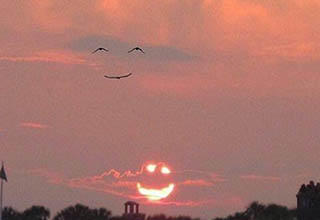 Birds that look like a person smiling. Sunset that looks like a smile.
