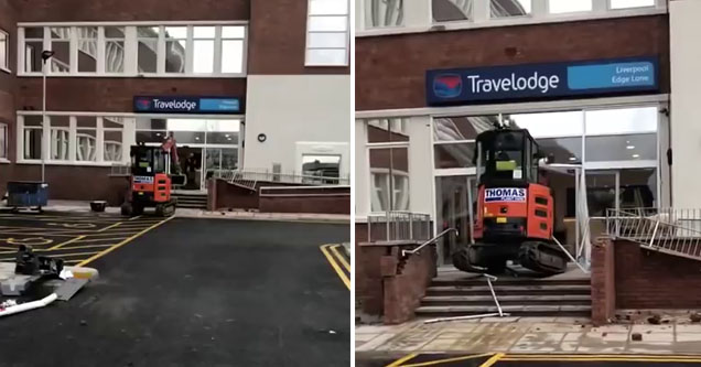 a excavator approaching a travel lodge and then boring through