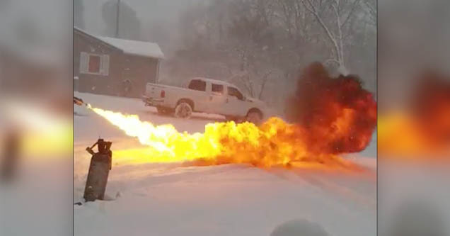 Derek Cook uses a flamethrower that he made himself to melt unwanted snow off his driveway in Grassy, Missouri in 2019.
