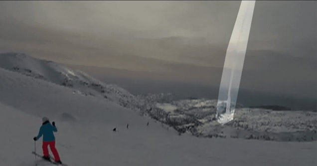 a man in orange ski pants and a blue jacked on the side of a snow covered mountain looks at a missile launched in the background