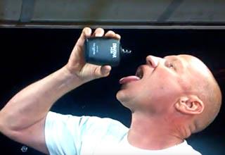 Guy drinking Drakkar Noir