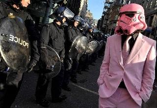man in pink suit and storm trooper helemt