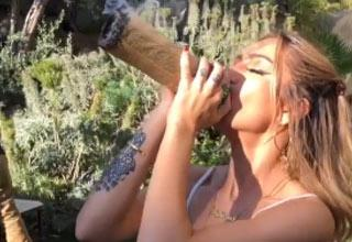a blonde girl smoking a large blunt