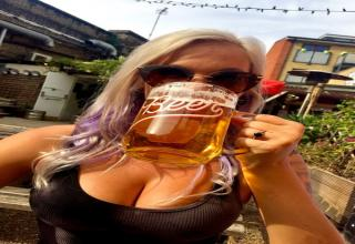 busty blonde girl drinking beer