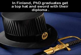 a top hat and sword with text about finland giving them to  phd graduates