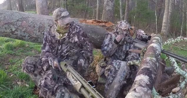 hunters wearing camouflage sitting in the woods while turkey hunting