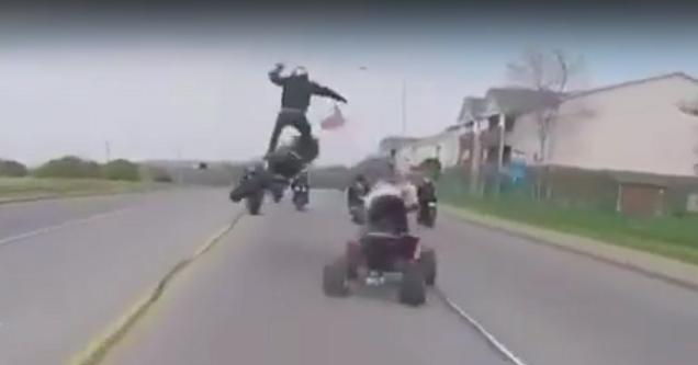 Guy's bike hits a quad and gets some air.
