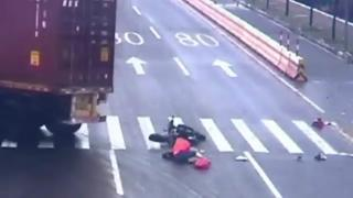 Woman On Scooter Narrowly Escapes Death By Truck In China view on ebaumsworld.com tube online.