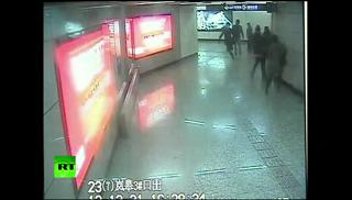 Dude Sticks Out Foot, Trips Fugitive Running From Chinese Cops view on ebaumsworld.com tube online.