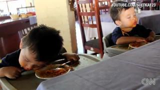 Twins Fall Asleep Eating Spaghetti. Cute view on ebaumsworld.com tube online.