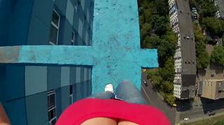 Russian Girl Walking On The Roof view on ebaumsworld.com tube online.