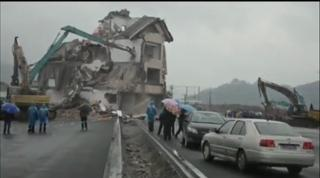 Chinese Home With Highway Built Around it Demolished!!!! view on ebaumsworld.com tube online.